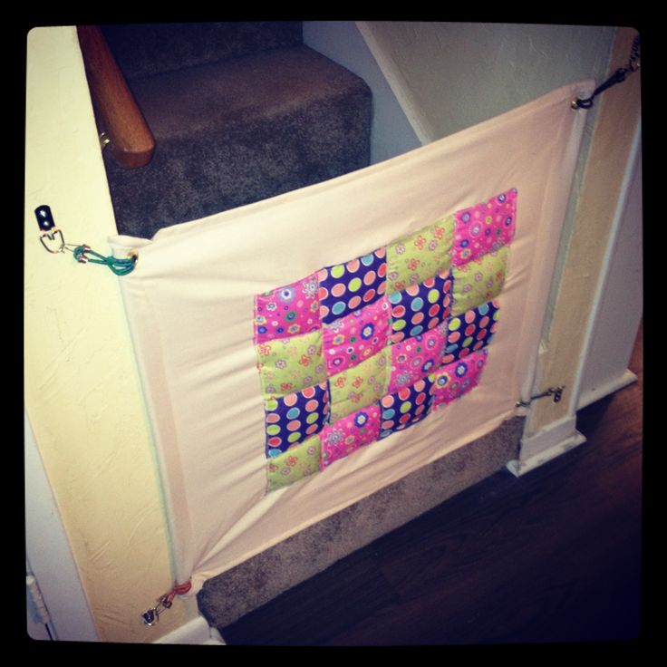DIY baby gate- fabric with large eyelets, on hooks... this might work. Wonder if I could use heavy Command Hooks? Something that's not very noticeable when the gate is down...