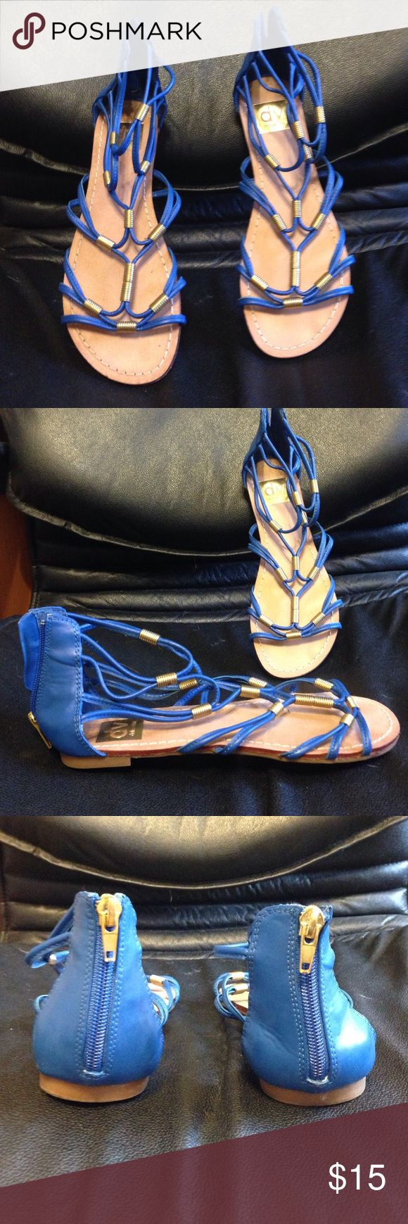 Blue DV by Dolce Vita gladiator flats size 8! Bright and funky royal blue gladiator flats with gold details by DV by Dolce Vita. Not positive, but I believe they are faux leather. DV by Dolce Vita Shoes Flats & Loafers