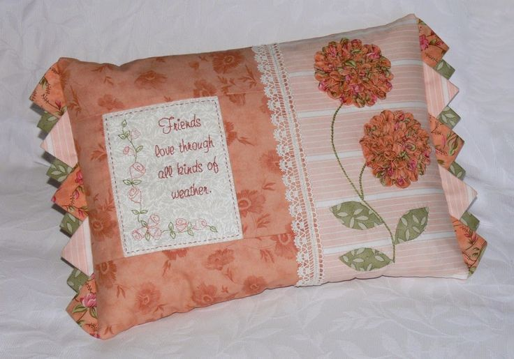 """""""All kinds of weather"""" is a pretty cushion with a sweet message. It features a number of embellishments that enhance this gorgeous design. Val Laird Designs"""