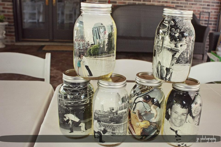 Oil filled quart size mason jars with our engagement photos. Made great rehearsal dinner decor.
