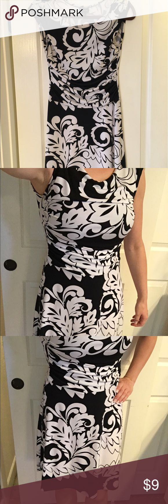 Black and white dress See last photo- very light yellowing under arm. Size is petite. Dresses