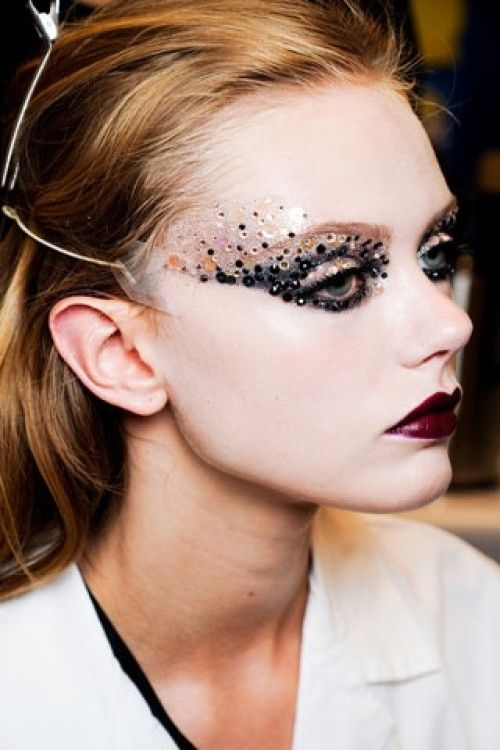 Dior runway makeup...add some sequins right across the bridge of your nose, and, voila, mask!
