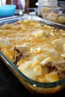 god i love breakfast food! 1 lb breakfast sausage 1 1/2 cups thinly sliced cooked, unpeeled red potatoes 1 1/2 cups mixed shredded Cheddar & Monterey Jack cheese 6 large eggs, lightly beaten 2 cups whole milk 1 teaspoon mustard powder 1/2 teaspoon salt black pepper