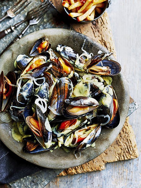 Very similar to moules marinière, this recipe for mouclade and frites is pepped-up with a kick of cayenne and pinch of curry powder, plus it only takes 30 minutes.