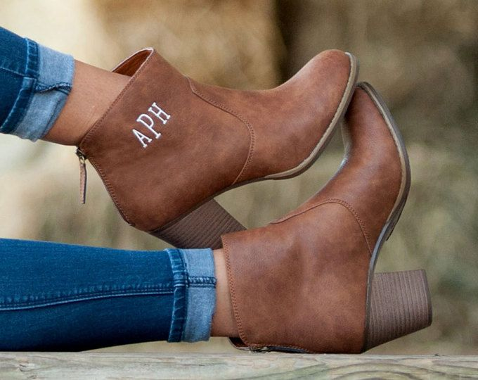 Brown boots size 8 with white vine/cursive monogram