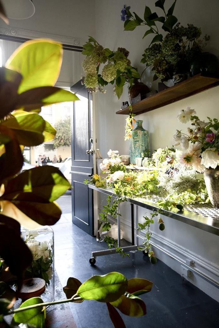 """Why a flower shop? """"It's really hard to communicate the scope and texture of what I do,"""" she says, """"so I wanted a physical space where people can walk in and smell lemon verbena and quince and Saint Helena sage."""" / """"What I find is green, wild, and unpatterned,"""" Louesa says. """"Not things that are manipulated, manicured, sprayed, and uniform."""""""
