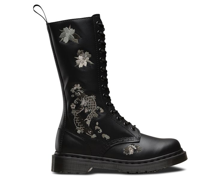 Think of a solid, sturdy working boot, laced to the nines and decorated in intricate Japanese tattoo art. This playoff between hard and soft is something stylist Ray Petri played with in the 1980s and something we've dug out of our archives to resurrect this season. This 14-eye style is made in a soft, lightweight leather and sits on our signature air cushioned sole.