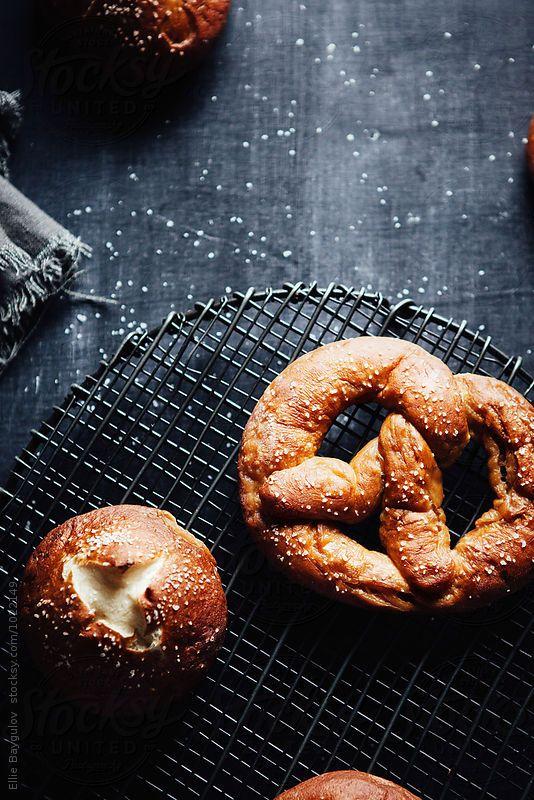 Overhead shot of homemade pretzels and buns