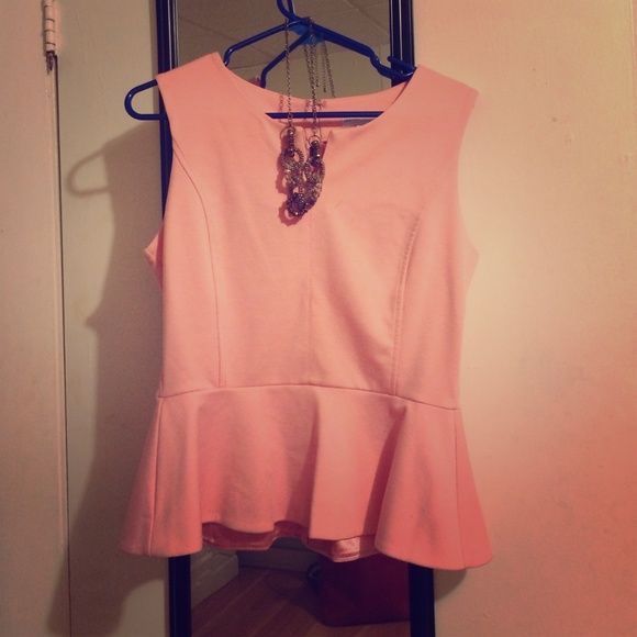 SALE Gorgeous Light Pink Peplum Top! Gorgeous light pink peplum top in excellent condition! Great quality material and very flattering fit. Could be used for work, going out, etc. Size medium New York & Company Tops