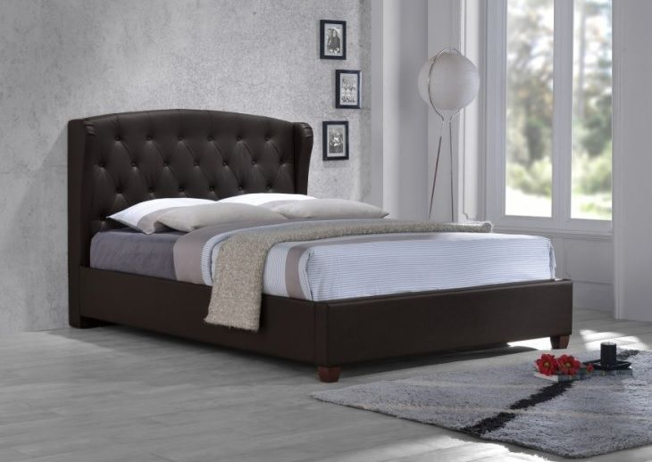 The ultimate in sophistication, the Prague leather bed frame features decadent detailing and a winged headboard upholstered in luxurious brown faux leather.
