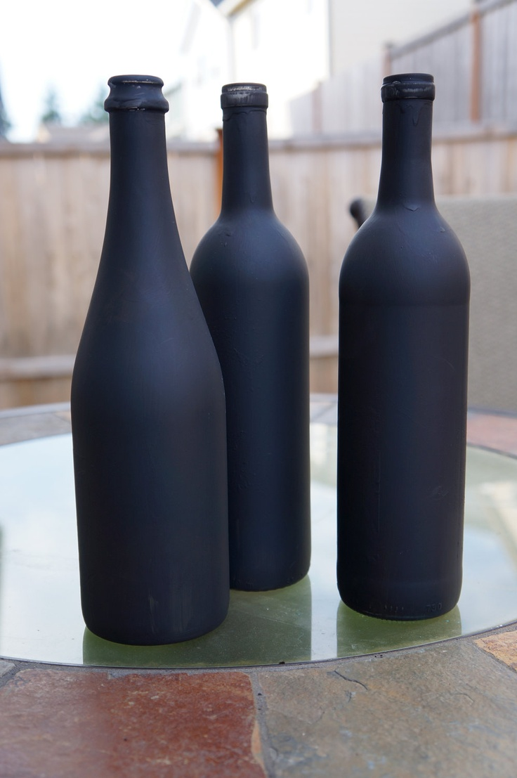 Wedding table numbers. Chalkboard painted wine bottles....could be really cute with mason jars as well.