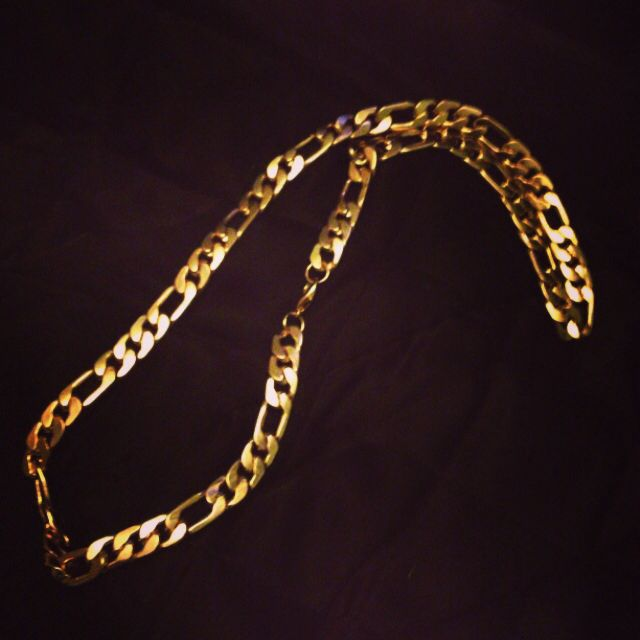 Mens Gold Chain. With Gold Bracelet/Watch. On Black T-Shirt, Black Skinny Jean, Black or White Trainers.