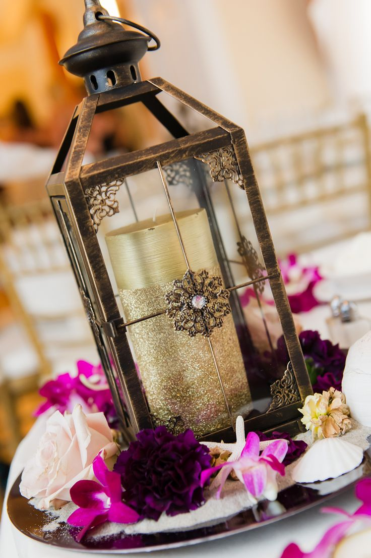 we could use the lantern and get charger plates for underneath with florals or something else.