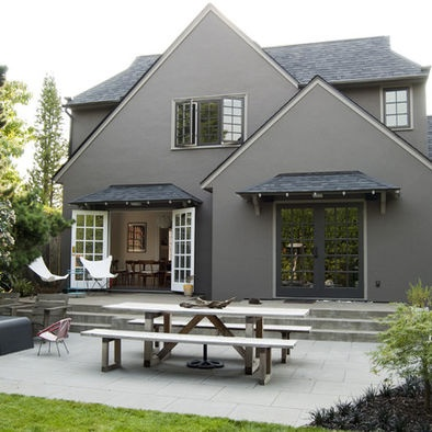 Gray Stucco House With Quoins Design..