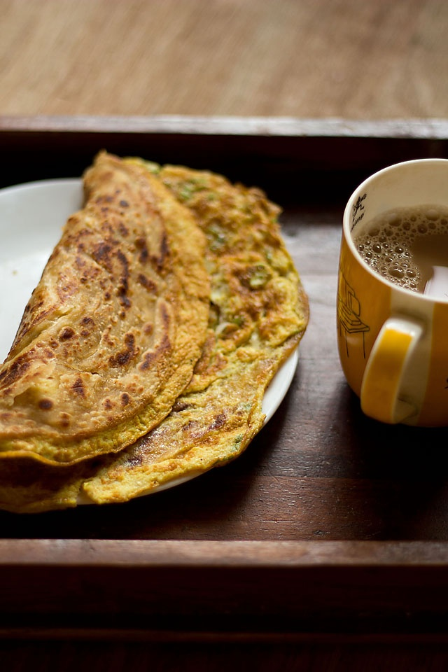 """EGG PARATHA aka BAIDA ROTI (whole wheat flat bread with spiced egg omlette) ~~~ this share is from her mother's kitchen. paraphrased, """"i am making these with whole wheat flour, but they are also often made with maida or all purpose flour (crispier and flakier). they are usually served with a chicken or meat mince filling.""""  [India] [vegrecipesofindia]"""