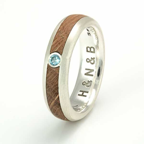 Love this Silver ring with an inlay of oak and a sky blue topaz stone from eco wood rings