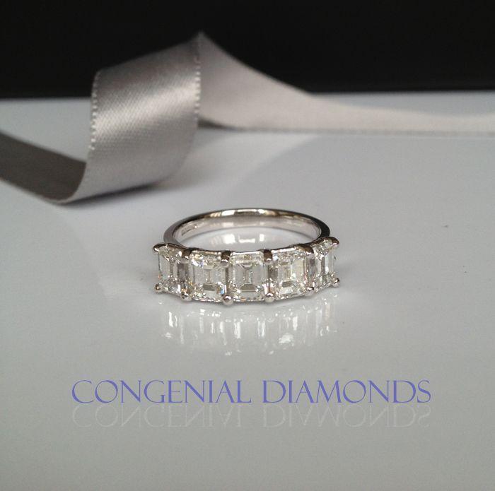 FIVE stunning emerald cut diamonds, ONE spectacular eternity ring