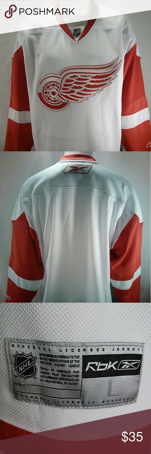 Reebok CCM NHL Red Wings Hockey Jersey Red White This is a nice pre owned Men's Large Red Wings Red and White Jersey. It is made by Reebok and of 100% Polyester. It has a nice Red Wings Logo on the front and Reebok logos on the sleeve and back of the neck. Great Jersey for any Red Wings fan! The measurements are Length 32 inches, Pit to Pit 28 inches, and Sleeves are 22 inches. Any questions please feel free to ask. Reebok Shirts Sweatshirts & Hoodies