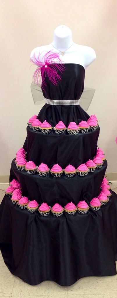 Three tier black dress with pink cupcakes display stand