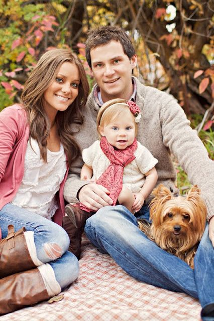 Blush Pink and tan. Look at that baby wearing a scarf! :D adorable.  Very nicely coordinated -- also, cute pose.