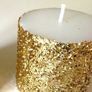 Glitter candle * Plain pillar candle *Spray with adhesive *roll in glitter *Blow off excess