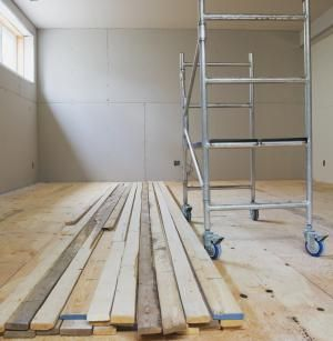 4 Basement Subfloor Options For a Dry, Warm Floor Covering: Basement Being Finished With Sub-Flooring