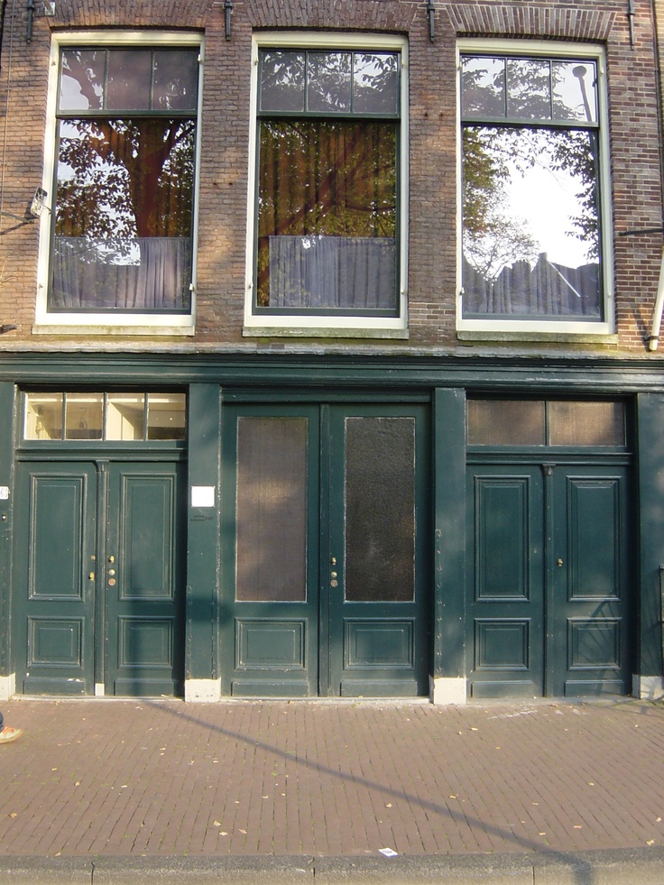 The Anne Frank Haus - Amsterdam - The street front entry to the building that housed the business where Anne's father worked prior to moving the family to the upstairs Annex during WW II. The museum entrance is now around the corner.