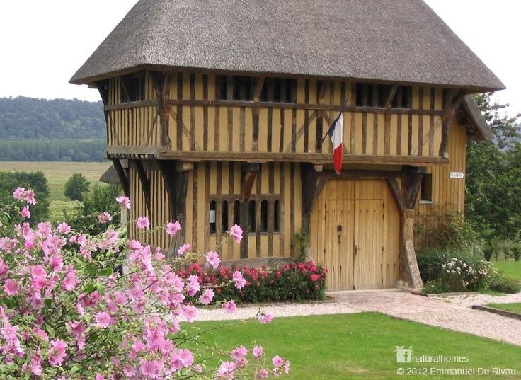 This oak frame building is almost 600 years old. It's the town hall (Mairie) of Saint Sulpice de Grimbouville in France. It was originally built in the nearby town of Selles, 12Km away, in 1420 by English carpenters during the Hundred Years War. In 1996 it was threatened with demolition but saved by the people of Saint Sulpice de Grimbouville along with three other cottages.