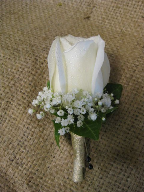 Simple white rose boutonniere with gypsophilia, ivy leaf and gold ribbon wrapped stem. #boutonnieres #flowers #rose #wedding