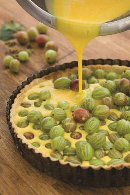 Sarah Raven's delicious gooseberry tart is simple to make and perfect to serve at a summer dinner party with a dollop of thick cream.