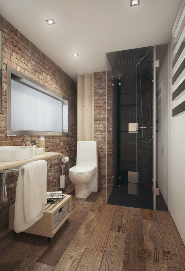 This neat bathroom is actually part of a very bijou loft apartment. The natural brick finish flows throughout giving integrity to the entire space.