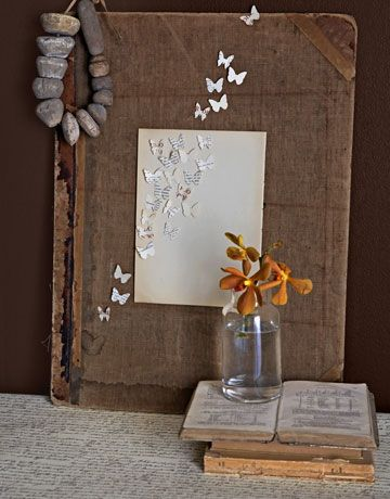 this one was so cute//Antique Book Art  Rescue an abandoned book, and present it as a still life. Adorn a dilapidated atlas with delicate butterflies, their winged shapes the product of a butterfly craft punch. Glue a page from a discarded novel to the cover before affixing the butterflies with glue dots to look as if they fly off the page    Read more: Recycled Craft Ideas - Crafts from Recycled Materials - Country Living