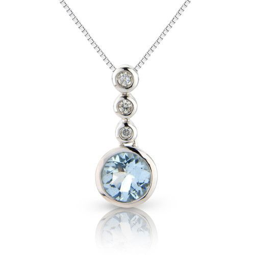 A simple yet elegant Aquamarine and Diamond pendant. In 9ct white gold, the rub over set stones drop 17mm from the fine trace chain they are suspended on.