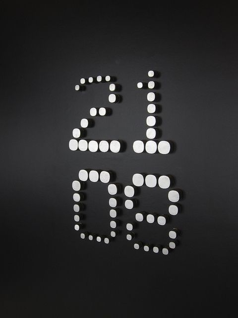 Signage idea. #signage #wayfinding #system #design #numbers #numerical #circles #black #white #wall #3D #eight #twenty-one #indoor