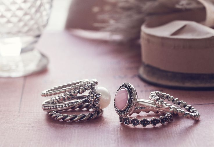 Ring upon a ring. Decorative Pandora heart, flower twist bands with cultured pearl and pink opal.  So feminine.