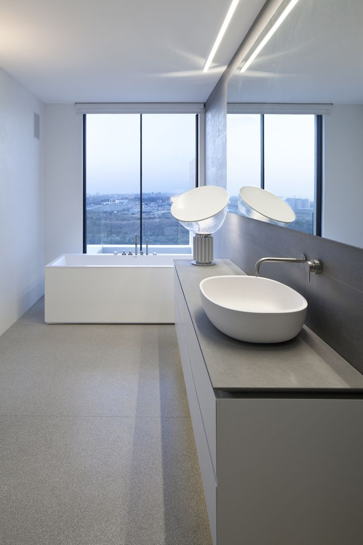 A super stylish bathroom deserves a super stylish modern lamp. Enter, the FLOS Taccia Table Lamp.