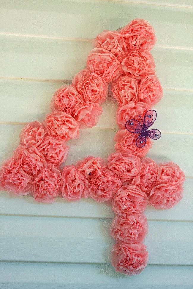 love this wreath, glue tissue paper roses to whatever template you want--soda tab on back to hang