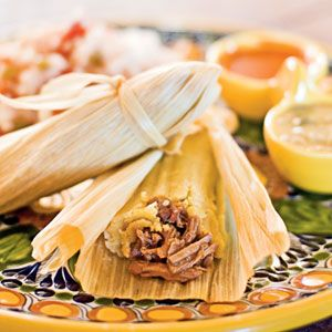 Beef Tamales | MyRecipes.com - Pork is the traditional filling for tamales in New Mexico, but since we use pork in Carne Adovada, we chose beef filling for these tamales. Adjust the ground chile for more or less heat as you prefer. If this recipe makes more tamales than you need, freeze for up to a month.