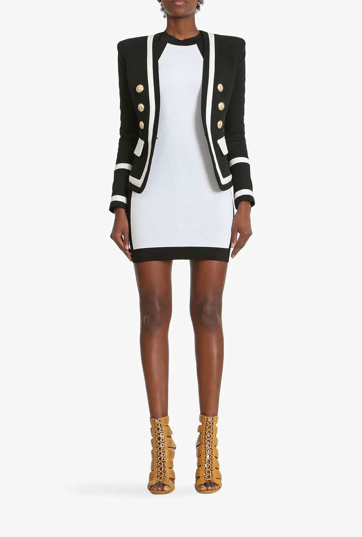Adorned with gold coloured engraved buttons, this two tone cotton blazer has flattering padded shoulders to emphasize the silhouette.Balmain, Spring-Summer 2015, Women, Blazers Online Store