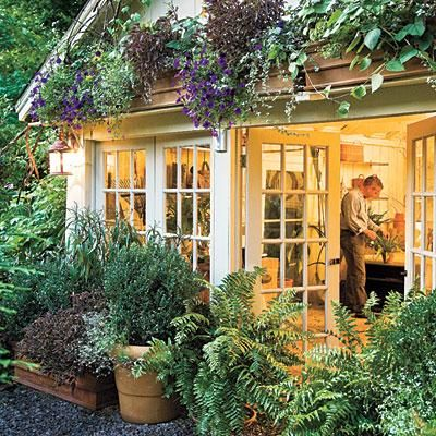 Hide Outdoor Structures | Sheds, garages, and outdoor workspaces are not always the most attractive in your yard. Use these spaces as a setting for a beautiful display of plants and flowers. | SouthernLiving.com