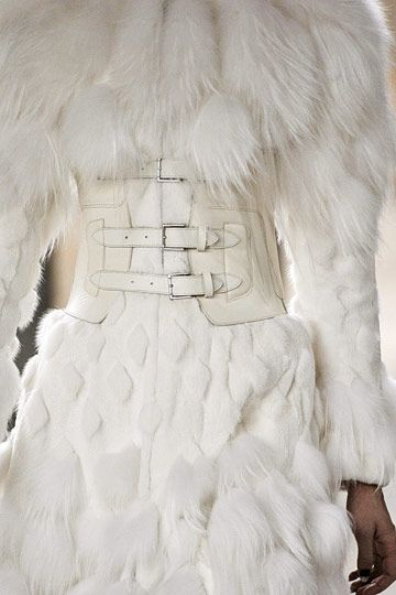 Alexander McQueen Fall 2011. The corset and the animal fur                                                                                                                                                                                 More