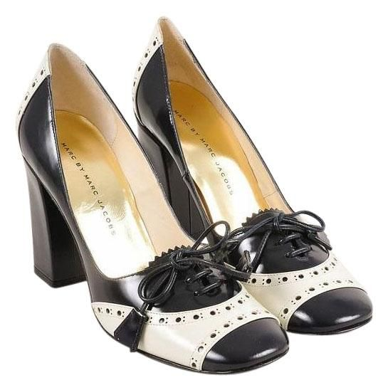 Marc By Marc Jacobs Spectator Oxford High-gloss Leather Navy/Cream Pumps. Get the must-have pumps of this season! These Marc By Marc Jacobs Spectator Oxford High-gloss Leather Navy/Cream Pumps are a top 10 member favorite on Tradesy. Save on yours before they're sold out!