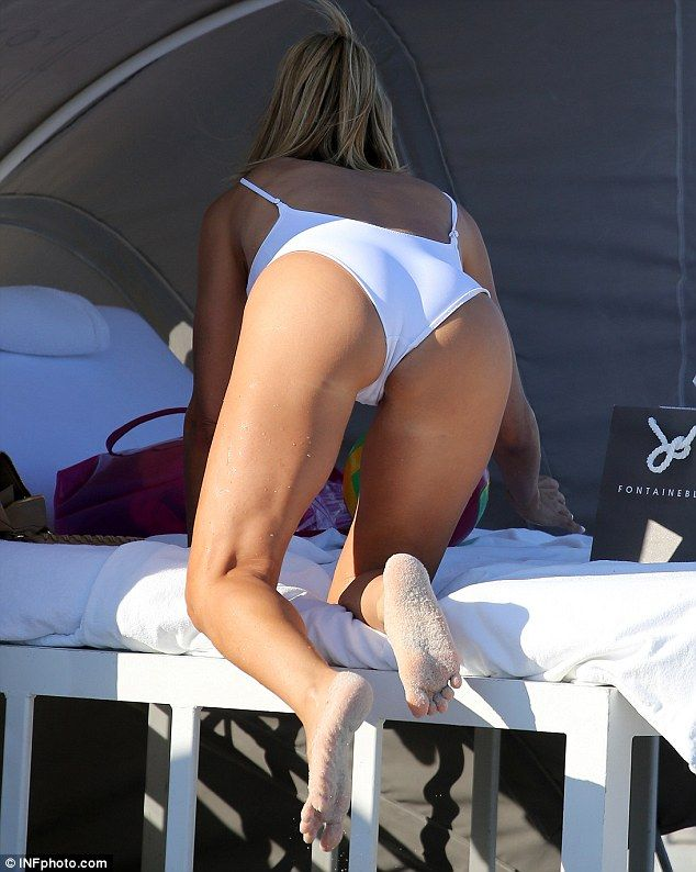 Cheeky! The former Real Housewives of Miami star showed off her fine form as she enjoyed a relaxing day in the sun