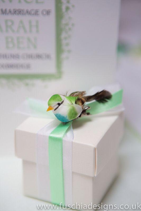 Beautiful ribboned wedding favour box with bird embellishment. A great woodland wedding favour. www.fuschiadesigns.co.uk