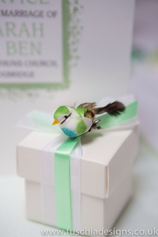 Beautiful ribboned wedding favour box with bird embellishment. A great woodland wedding favour. www.fuschiadesigns.co.uk