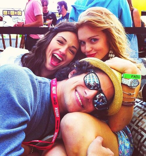 Crystal Reed, Tyler Posey, Holland Roden... Is that Dylan in the reflection of Tyler's glasses?