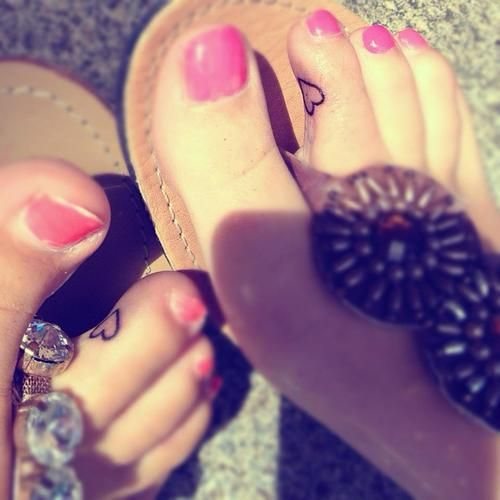 matching toe tattoos