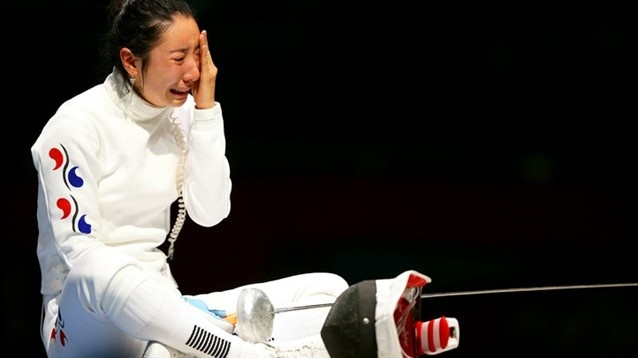 A Lam Shin of Korea cries after losing to Britta Heidemann of Germany in the women's epee individual fencing semifinals.