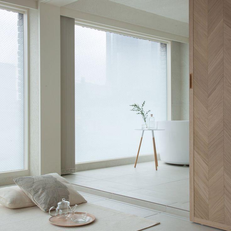 Hiroyuki Ogawa Architects divides up tiny Tokyo apartment with sliding screens
