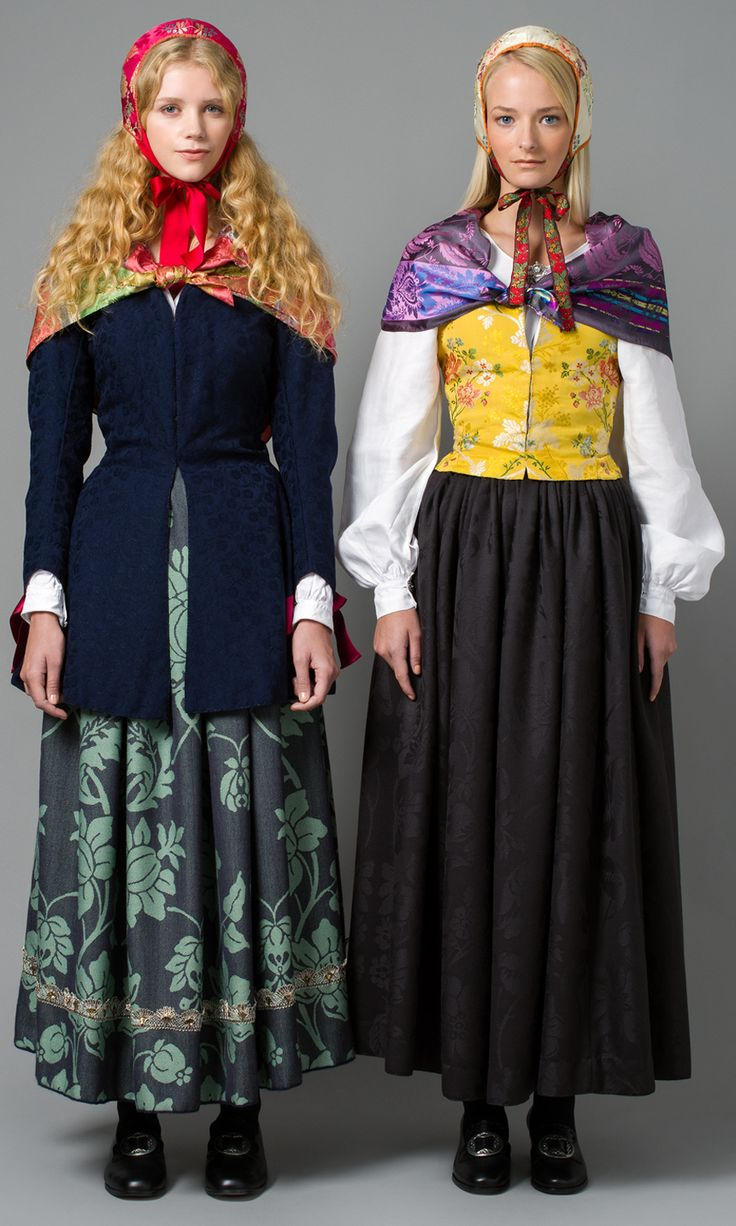 1700 - TALLS KVINNEBUNAD FRA GUDBRANDSDALEN Bunaden går ut fra drakttradisjonene fra slutten av 1700-tallet til tidlig 1800. Folkedraktene på denne tiden kjennetegnes ved sine svungne sømmer og bruk av importerte silke- og ullstoffer.